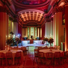 Upper Library transformed as a dancefloor and dramatised with the magenta and salmon pink lighting - photo credit Duke Photography